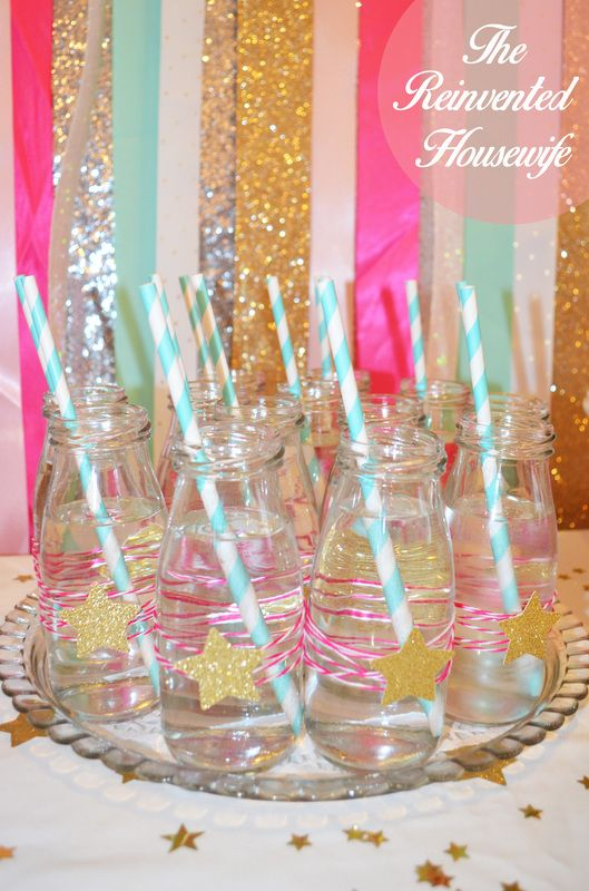 Twinkle twinkle little star baby shower from The Reinvented Housewife! gold silver glitter aqua pink paper straws milk bottles chocolate cake girl birthday party mocktails champagne flutes edible glitter