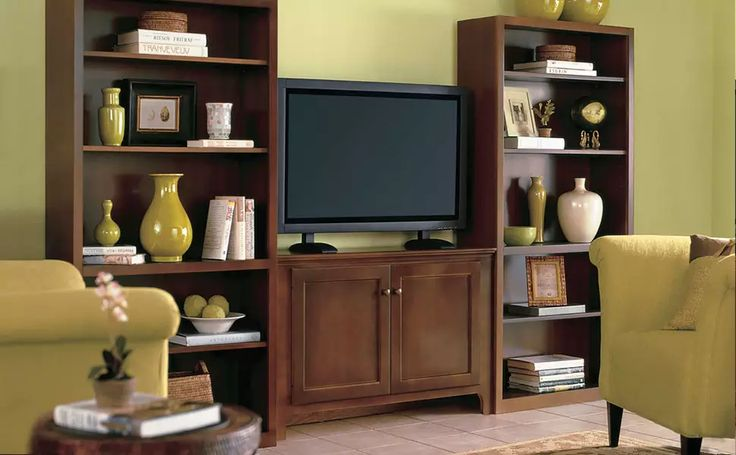 This entertainment center is actually three separate pieces - two book cases and a console table - that were purchase at an unfinished furniture store.