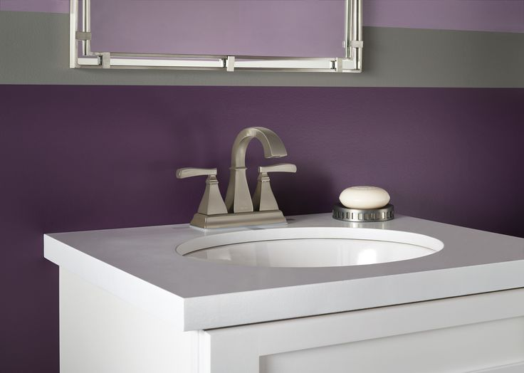White single bathroom sink with purple painted walls and brushed nickel  faucet from the Delta Faucet. Top 25 ideas about Brushed Nickel Brilliance on Pinterest