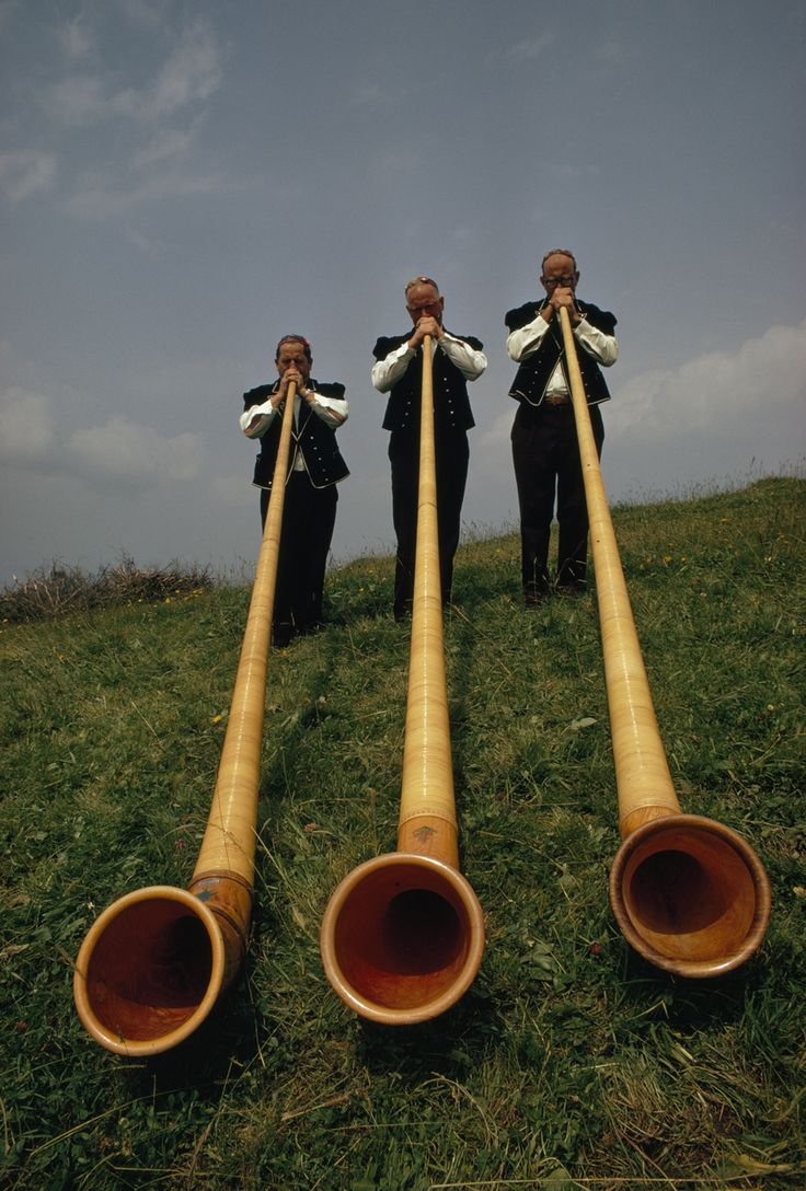 Swiss men playing 12-foot-long alpenhorns at a midsummer Alpine Festival in Switzerland, 1973.Photograph by James P. Blair, National Geographic