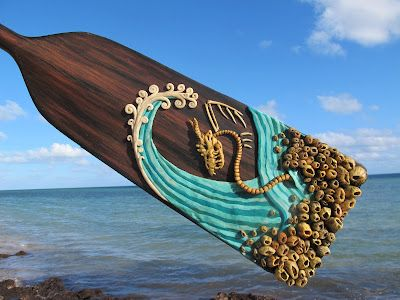 Upcycling - an artist uses a retired Dragon Boat paddle to make an amazing display piece.