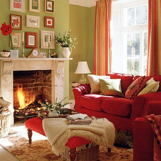 Green living room with red sofa, stool and curtains | housetohome.co.uk