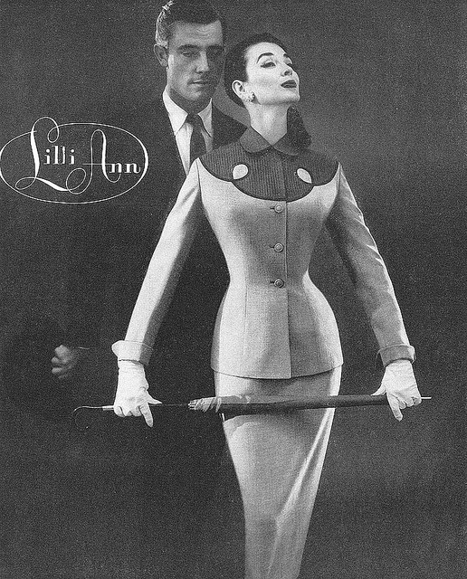 Dorian Leigh in Lilli Ann ad, photo by Roger Prigent for Vogue Feb. 1956