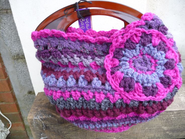 pinks and purples crocheted bag. £15