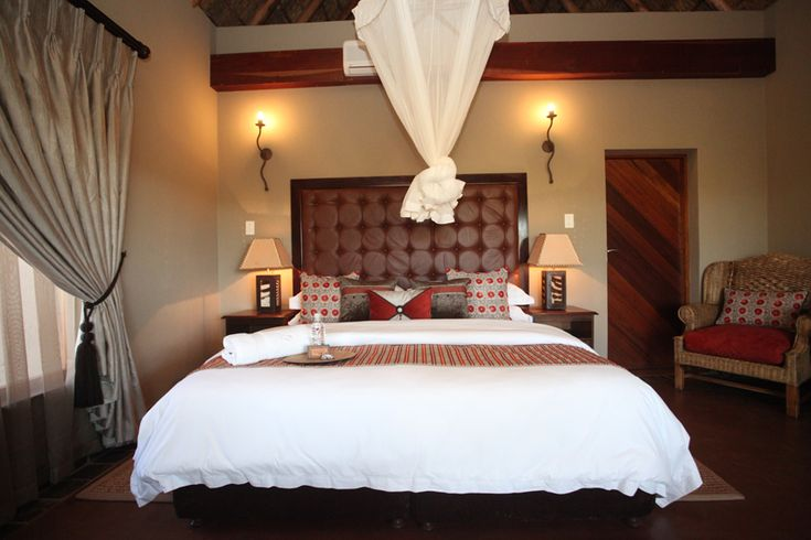 Matingwe Lodge & Private Game Reserve The Executive Suite is nestled next to the main lodge, with a private entrance from the lodge. A secluded patio overlooks the savannah plains. In Winter, cuddle up in front of the warm fireplace. The suite is equipped with a king bed (and sleeper couch on request), fireplace, air-conditioning, ceiling fan, safety deposit box, mini bar, tea/coffee station, en-suite bathroom with shower, bath and toilet, with a range of luxury amenities.