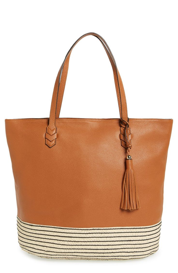Carry spring and summer essentials in this neutral, everyday tote from Rebecca Minkoff! The plaited straw trim at the bottom adds a boho twist.