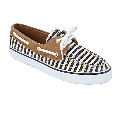 Bold navy stripes and gold details add a nautical flair to these Sperry boat shoes for women. BISCAYNE by SPERRY