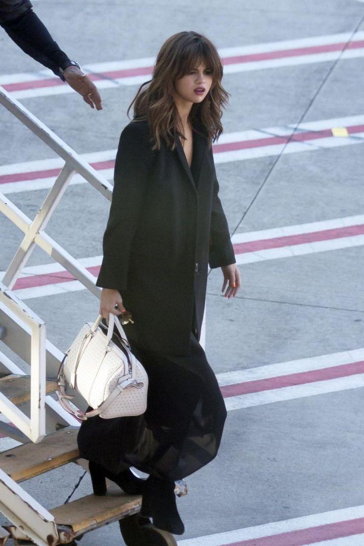 Selena Gomez wearing Louis Vuitton Sofia Coppola Bag, Dear Frances Spirit Boots and Atea Oceanie Spring 2016 V-Neck Slip Dress in Black Spandex Jersey