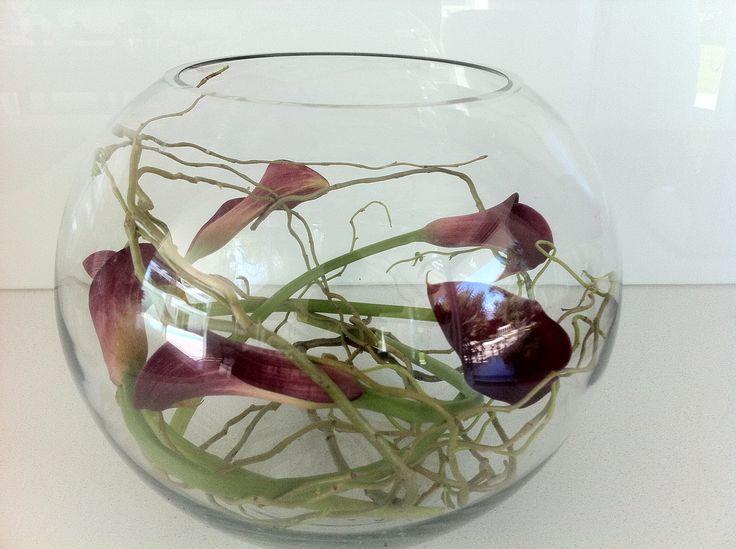 wine callas in fishbowl http://www.wanakaweddingflowers.co.nz/gallery/