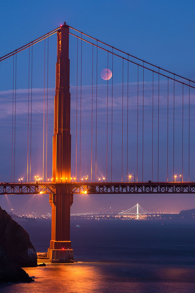 Supermoon lunar eclipse 2015.  That's the new Bay Bridge span in the background. And you can see half of Alcatraz on the left.