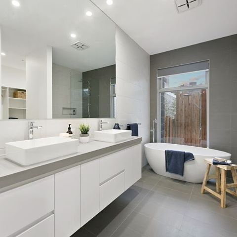 Sleek Concrete certainly lives up to its name in this sleek concrete bathroom by AMJ Constructions. We love the trend of mixing Concrete with natural elements like the wood stool
