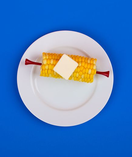 Golf Tees as Corn Holders | To keep your fingers off the buttery kernels, wedge golf-tee handles into the cob ends.