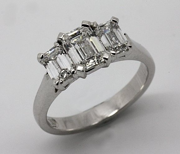 18ct White Gold Emerald cut Diamond trilogy Engagement ring.