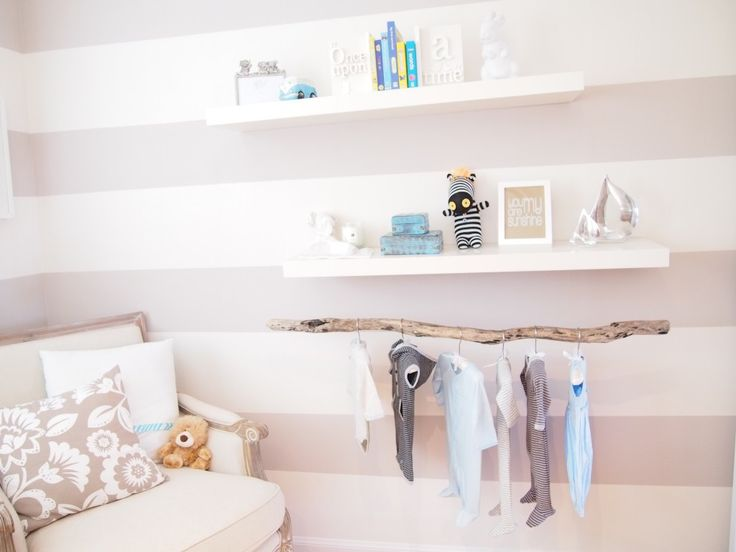 Baby room with driftwood clothing rack.