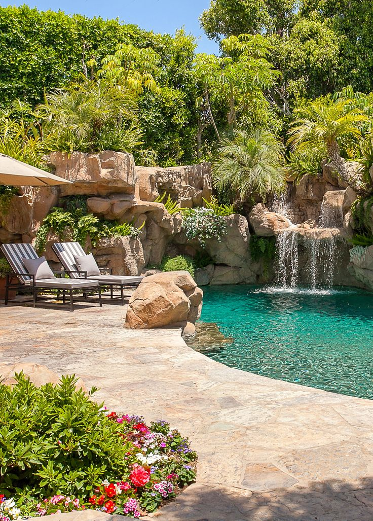 Outdoor patio and pool with stone waterfall (Santa Monica, California | @partnerstrust)