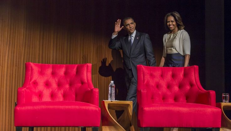 Mr. & Mrs. O make their way onto the stage before President Barack Obama speaks at the LBJ Presidential Library, Thursday, April 10, 2014, in Austin during the Civil Rights Summit to commemorate the 50th anniversary of the signing of the Civil Rights Act.