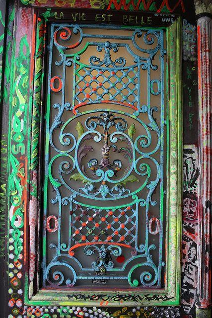Gorgeous colored iron scroll work on a Parisian doorway.Photo by Stefon Leijon.