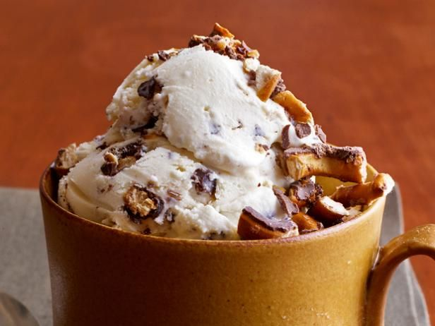 Sweet-and-Salty Ice Cream : Get a new flavor out of the classic vanilla sundae by serving it topped with chocolate-covered pretzels for a salty twist.