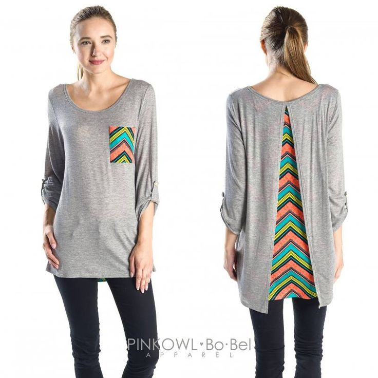 This top is pretty simple if you look at it from the front. A plain knit top with three quarter sleeves and a quite printed front chest pocket. This front pocket does add some color to the top, but it is the open back with a printed material inside that makes it unique.
