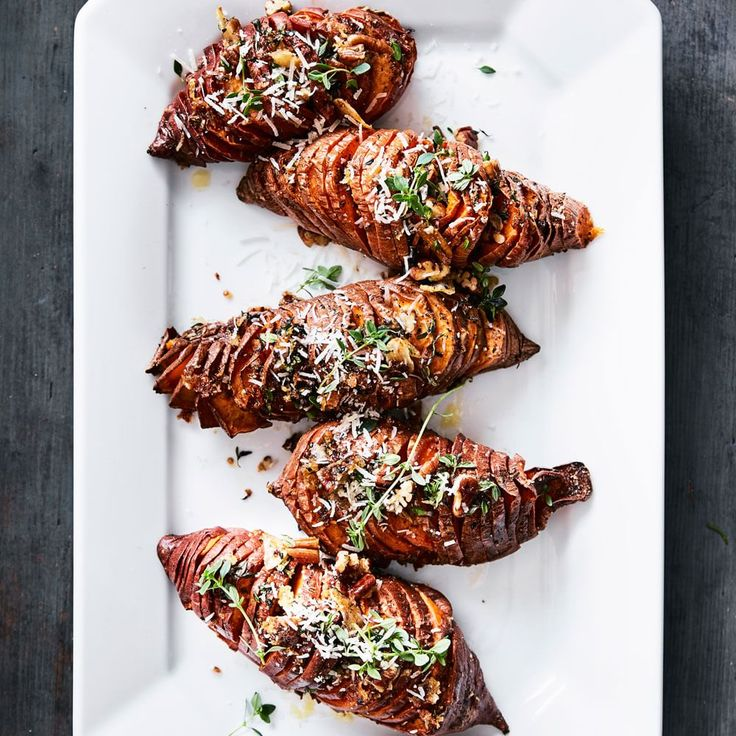 Hasselback Sweet Potatoes with Thyme, Pecans and Parmesan | Williams-Sonomahttp://www.williams-sonoma.com/recipe/hasselback-sweet-potatoes-with-thyme--pecans-and-parmesan.html