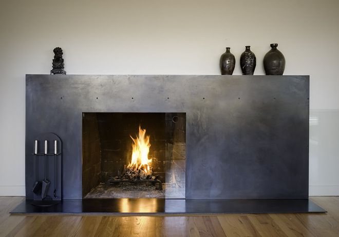 modern living room fireplace by BAAN design