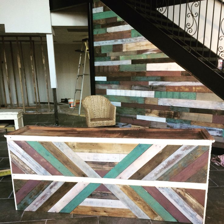 Pallet wall and cash wrap for lotus boutique in Metairie!
