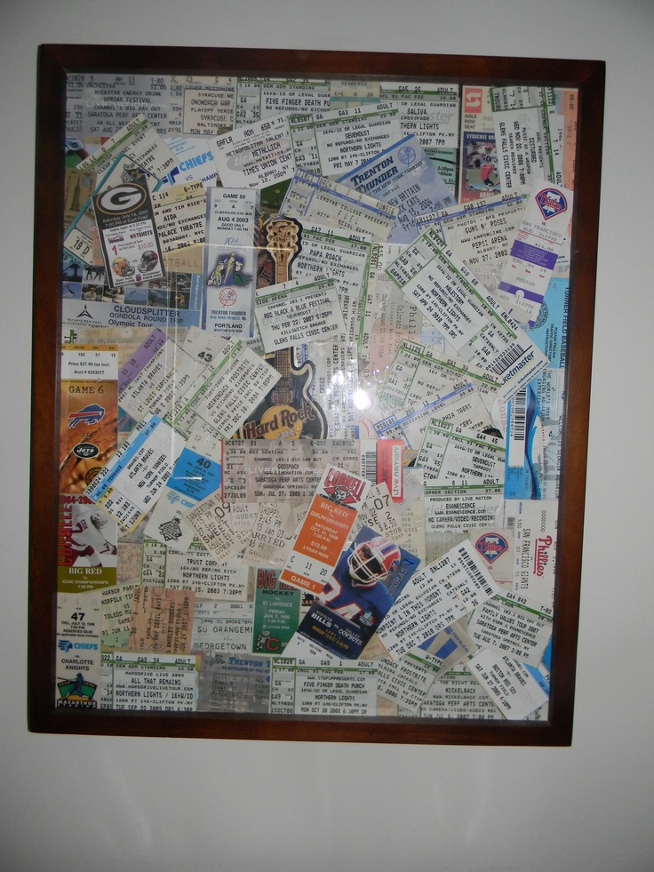 old concert and sports tickets in a simple frame