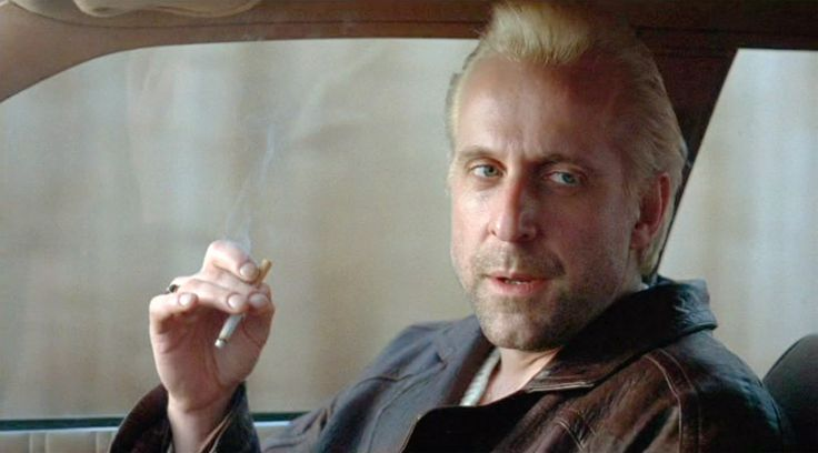 Peter Stormare smoking a cigarette (or weed)