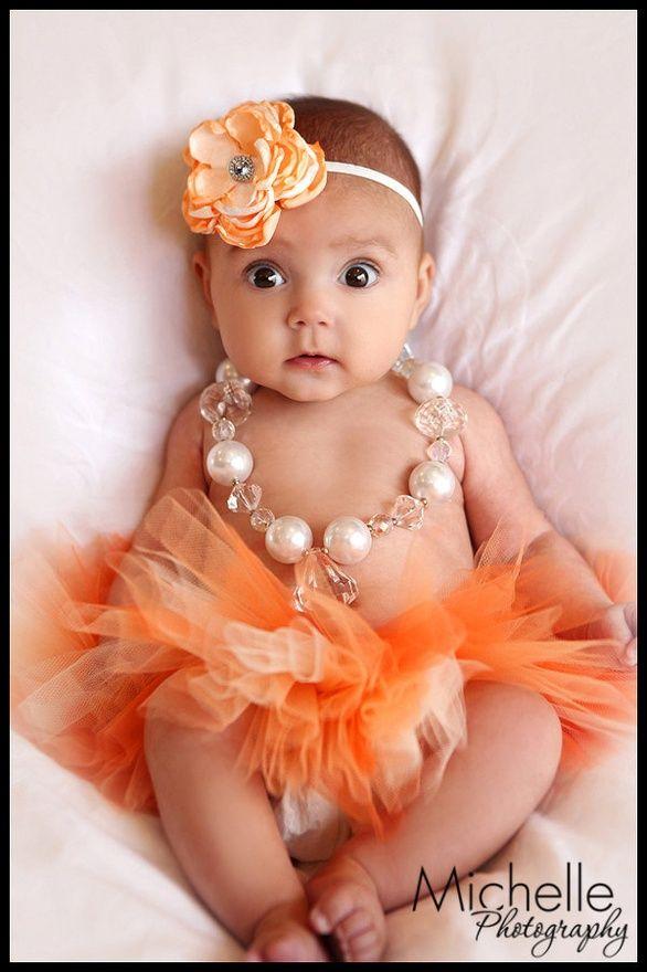 Newborn Infant Baby Girl Tutu with Matching Flower Headband, Peaches N Cream, Photo Prop, Birth Announcement. $29.50, via Etsy.