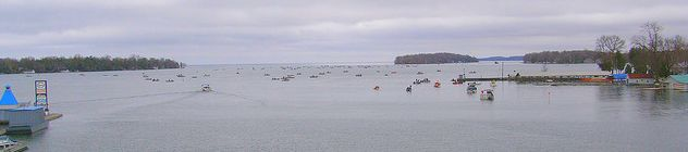 View looking south from the Narrows Bridge, Orillia ON during Perch Festival. Blue Beacon Marina is on the left.