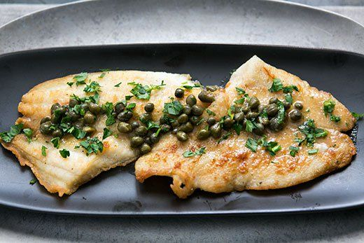 Sole Piccata ~ Petrale sole fillets, dusted in flour, sautéed in olive oil and served with a sauce of white wine, lemon juice, capers, parsley and butter. ~ SimplyRecipes.com