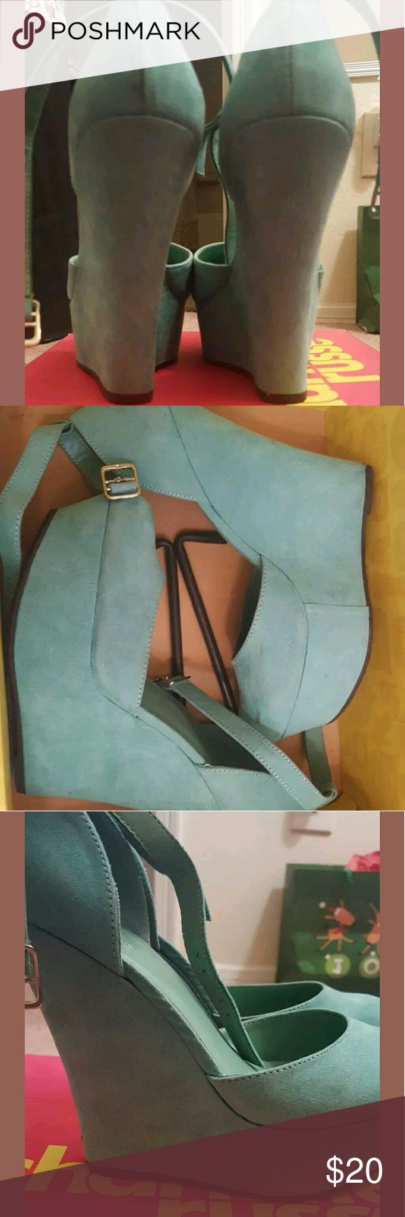 Teal Wedges Teal Wedge from Charlotte Russe worn maybe once or twice still in box very small scuff mark at peep of the right wedge small scuff on the back of left wedge. NICE SPRING COLOR Charlotte Russe Shoes Wedges