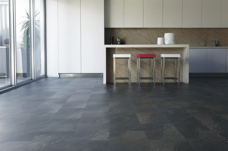 Add Allure Locking Charcoal Granite tile to your home for the robustness and elegance of real granite at an affordable price.
