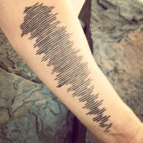 beautiful unobvious memorial tattoos....sound waves of a mother's last voicemail to her son
