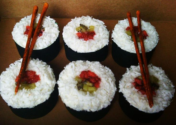 Sushi Cupcakes. Coconut, Strawberries, and Kiwis as toppings!