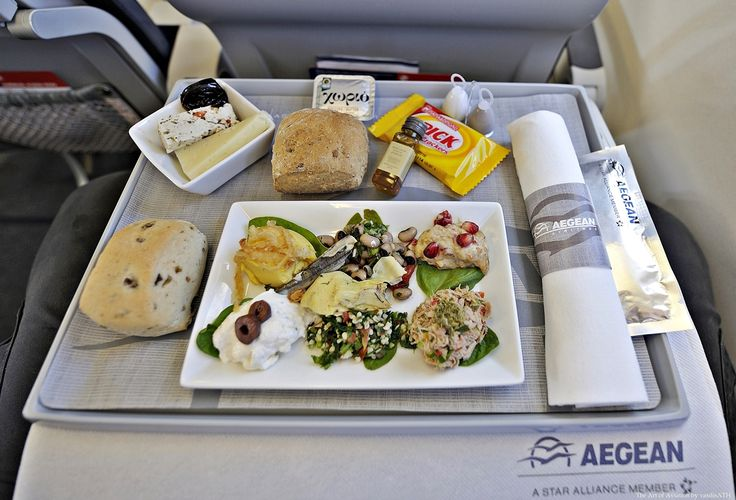 AEGEAN Business Class Appetizer The Greek Mezze Selection of Fava, Eggplant Salad,Tirokafteri, Tuna Salad, Black Eyed Beans and Artichoke Hearts, Tabouleh and Marinated Anchovies.