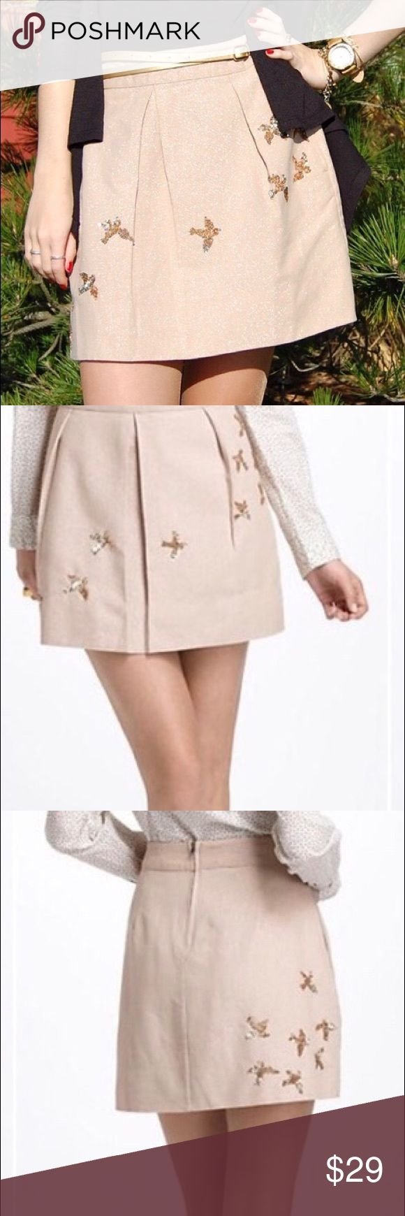 """Leifnotes 'Migration' Sequin Birds Twill Skirt Leifnotes Migration Skirt. Pale pink/beige shimmer twill with gold sequined birds in flight. Hip pockets. Lined. Soft pleats. Very pretty.  Minimal, gentle use. No holes or repairs. Clean! We note a minor defect: 2 tiny white spot (1/4"""" and 1/8"""") hidden in a pleat. Very minor and hard to see. Questions welcome. Anthropologie Skirts Mini"""