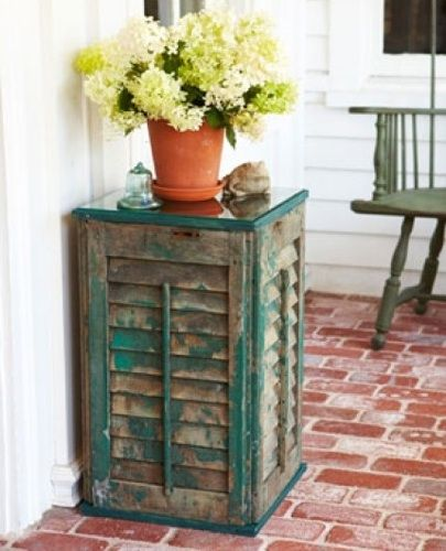 These old weathered shutters were transformed into a unique side table with nothing more than art canvas stretchers to provide framing; screws to secure shutters to stretchers; and a wood tabletop covered with glass. You can follow a step-by-step to make one of your very own at Good Housekeeping.http://www.goodhousekeeping.com/home/crafts/how-to-build-a-table