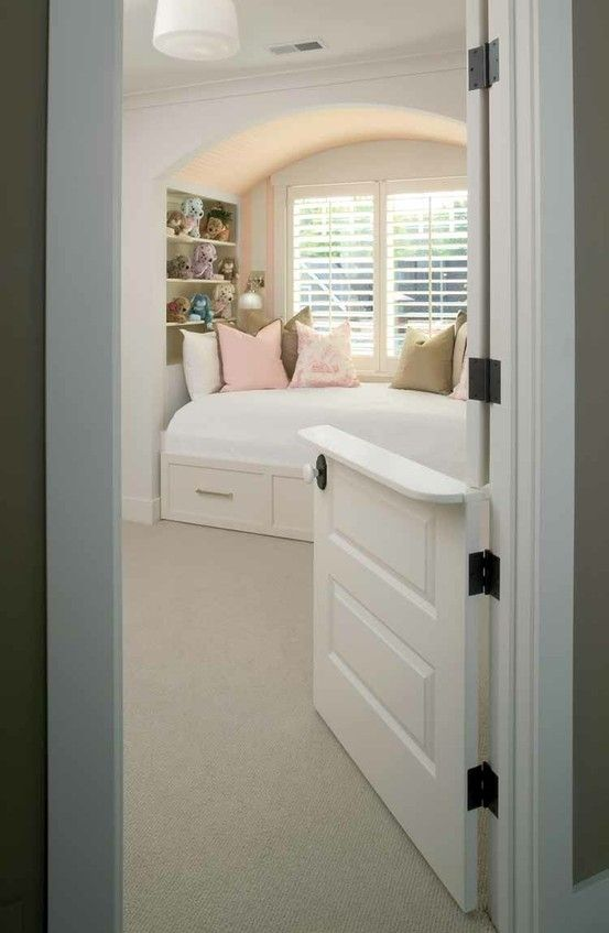 Comfy, cozy built-in bed & bookcases with dutch door. Cute for kids, but would be nice as a daybed type reading area for us 'older' types too.