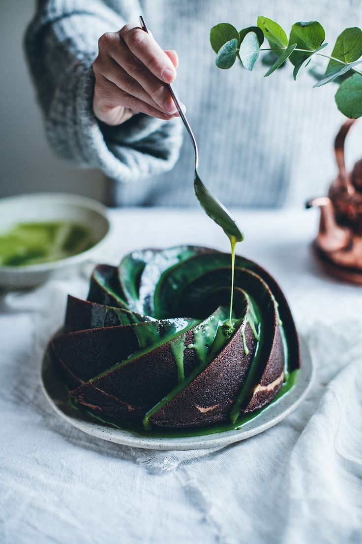 Cheesecake filled chocolate bundt cake with white chocolate matcha glaze