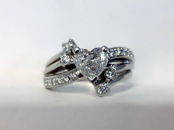 This Kimberfire ring, custom made for a mother of four, is bursting with love! Set in platinum is a 1 carat heart-shaped centre stone surrounded by four round diamonds, representing her children. Now being worn by a truly blessed fan.