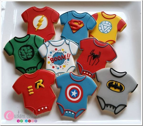 These adorable cookies were made by Custom Cookies by Jill for a superhero themed baby shower. I don't think I've ever seen superhero onesie cookies before and these are so cute! The nine cookies are: A Flash onesie with his lightning bolt chest emblem. A Superman onesie with his classic...