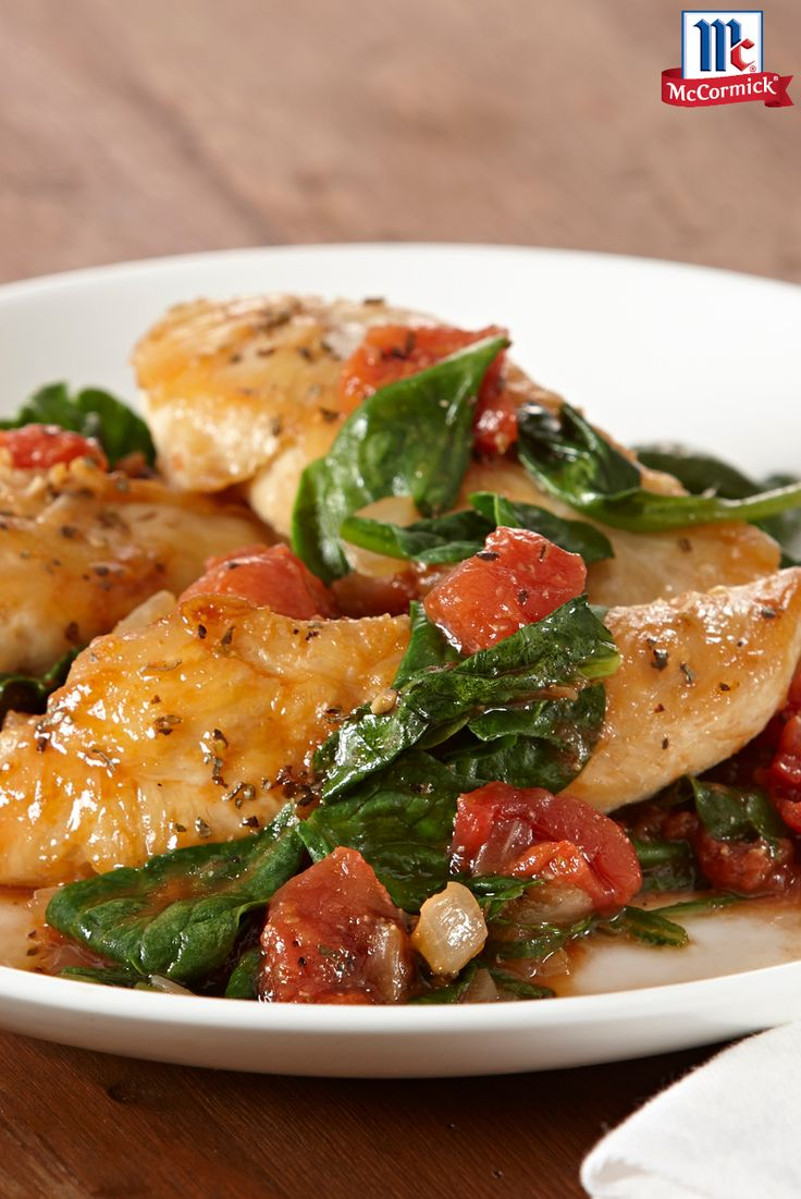 Ready in 30 minutes, this easy skillet chicken dinner features tomatoes and spinach. Serve over pasta or couscous for a light and easy weeknight meal.