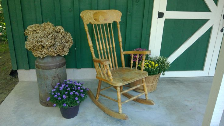 Sit a spell, relax and enjoy the view of he woods from the front porch of our garden barn.