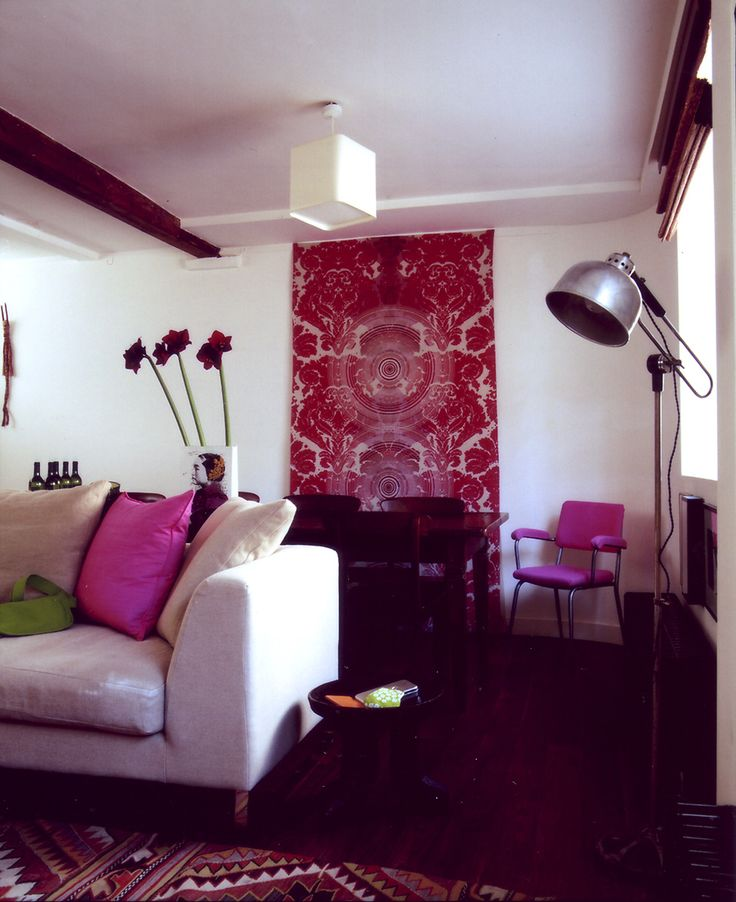 Tiny mews house living room in London wanted a big hit of colour. Pink.