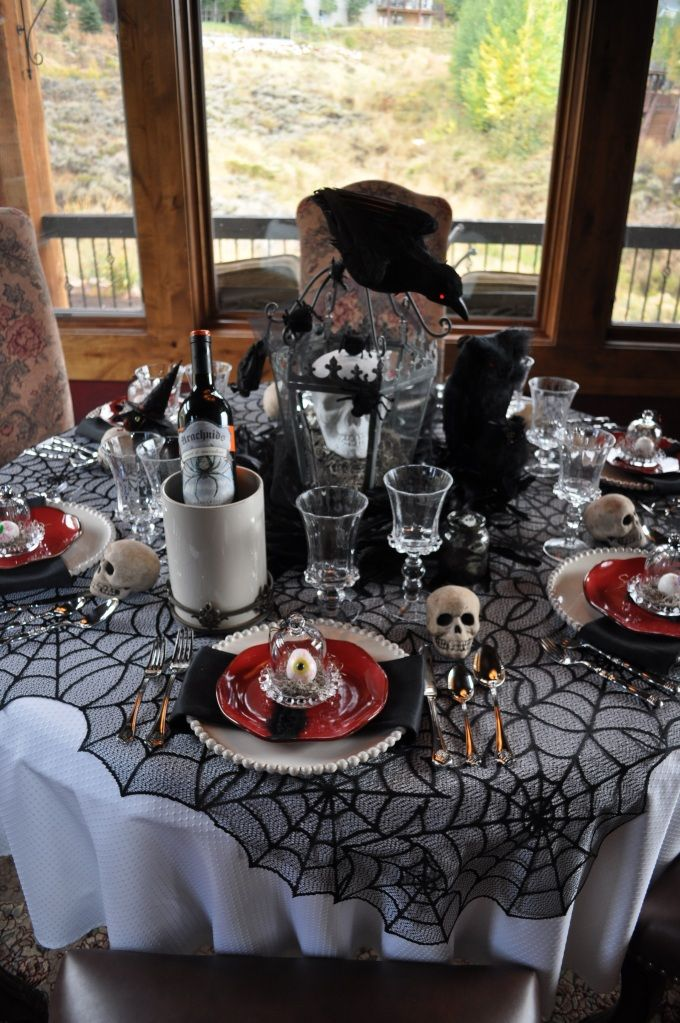 Beautiful Spooky Party Table Setting - i love the personal eyeball presented in a glass container.
