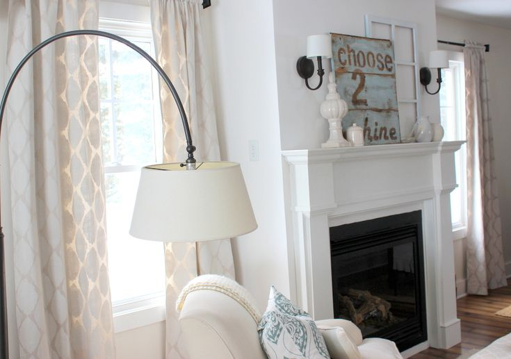 DIY Drop-cloth Curtains painted with stencil and small foam roller