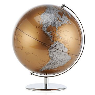 The traditional, functional world globe makes a new entrance with a dramatic flair. The earth's land masses are strikingly represented in metallic silver, with the water sources represented in metallic gold.