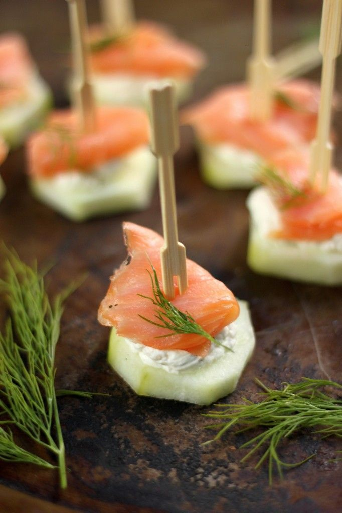 "Smoked Salmon and Cream Cheese Cucumber Bites / * 1 large cucumber, peeled and cut into 1/4"" rounds  * 4 ounces smoked salmon, cut into bite sized pieces  * 4 ounces cream cheese, softened  * 1/2 tablespoon horseradish  * 1 tablespoon fresh dill, chopped  * 1/4 teaspoon salt"
