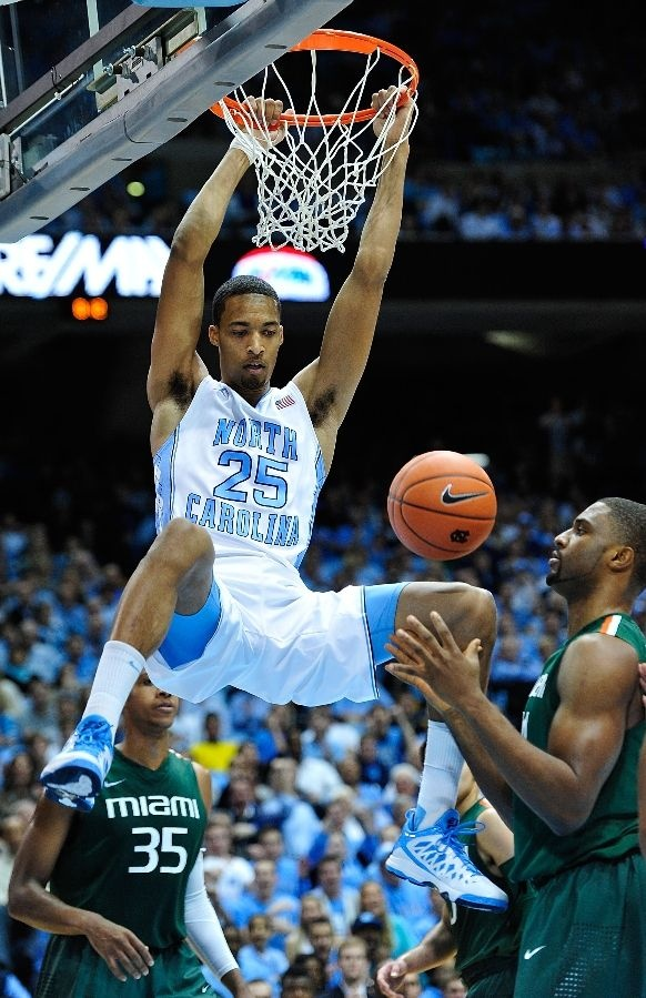 J.P. Tokoto #25 of the North Carolina Tar Heels dunks against the Miami Hurricanes during play at Dean Smith Center on January 10, 2013 in Chapel Hill, North Carolina.